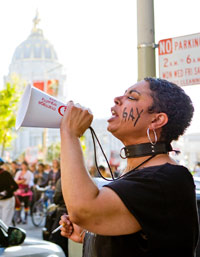 A woman leads the call to protest, photo by Silvia Ros