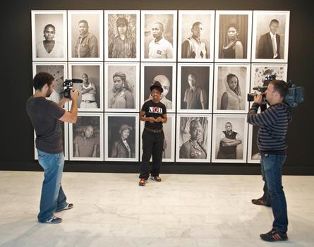 Zanele Muholi in front of her works